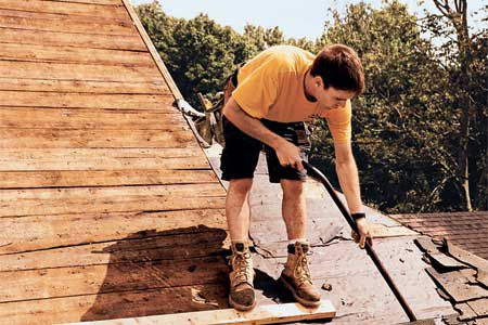 Man Removing Old Roof Sheathing