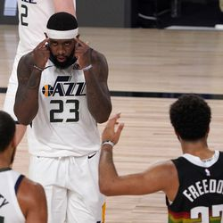 Utah Jazz's Royce O'Neale (23) celebrates with Rudy Gobert, bottom left, as Denver Nuggets' Jamal Murray (27) gestures following the foul call against his team after Gobert sunk a basket during the second half an NBA first round playoff basketball game, Tuesday, Sept. 1, 2020, in Lake Buena Vista, Fla.