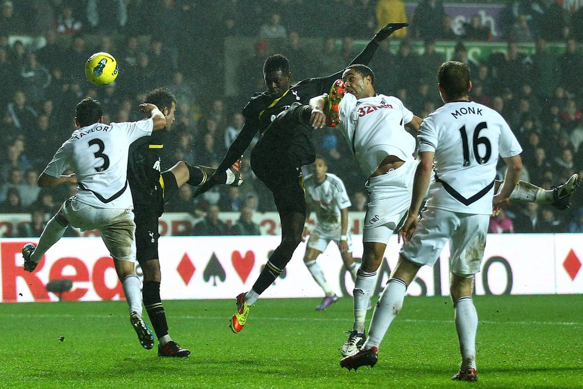 Emmanuel Adebayor of Tottenham sends  a header wide during the Barclays Premier Legaue match between Swansea City and Tottenham Hotspur at the Liberty Stadium in Swansea, Wales.  (Photo by Richard Heathcote/Getty Images)