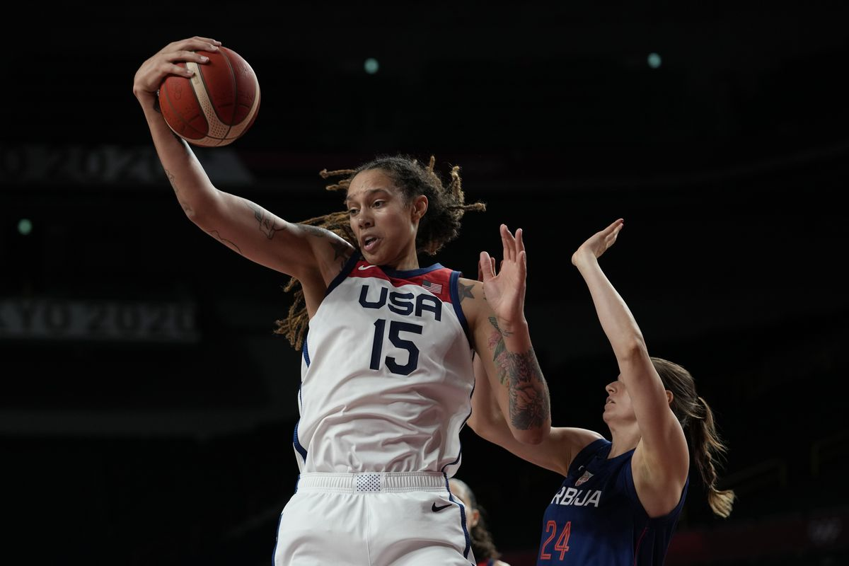 The United States' Brittney Griner (15) grabs a rebound ahead of Serbia's Maja Skoric (24) during women's basketball semifinal game at the Tokyo Olympics.
