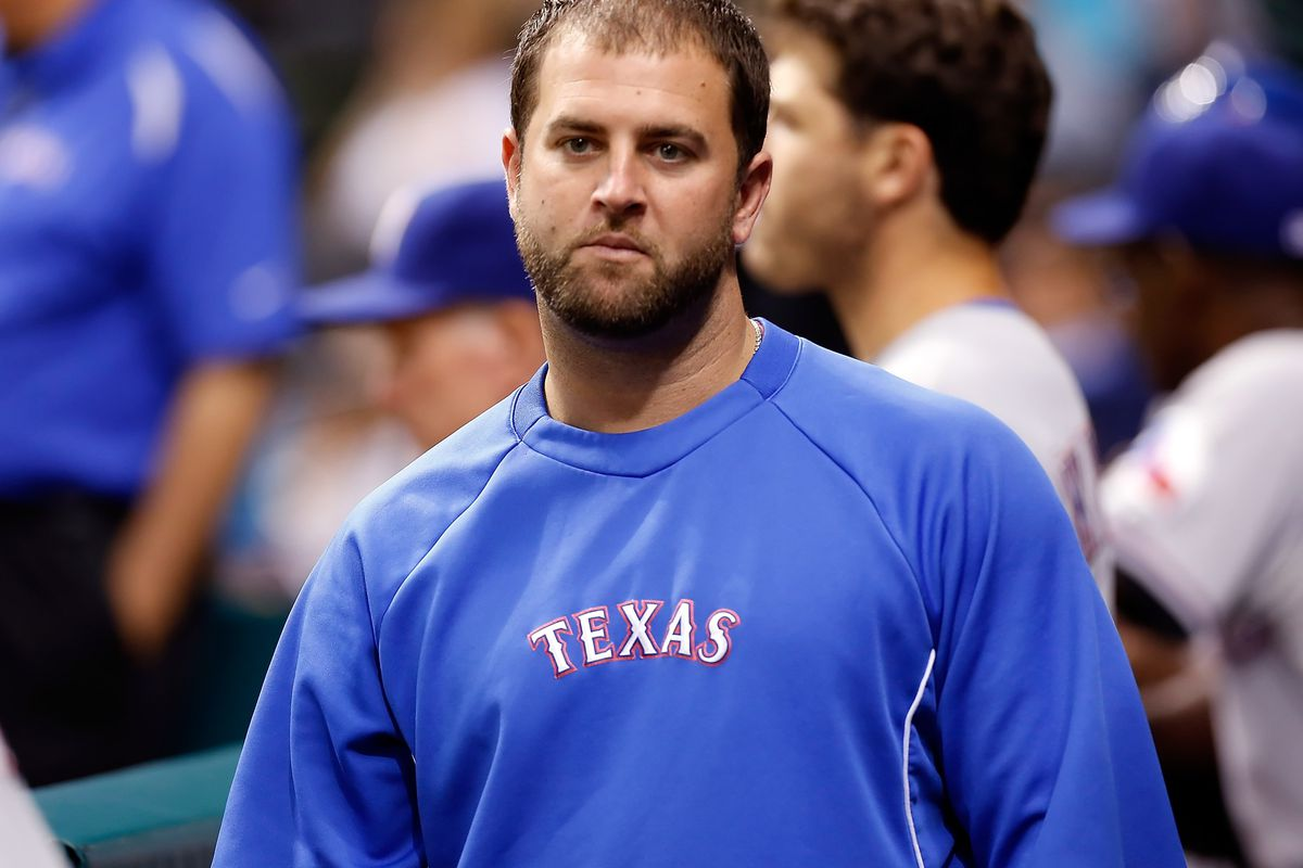 ST. PETERSBURG - SEPTEMBER 08:  Catcher Mike Napoli #25 of the Texas Rangers walks the dugout during the game against the Tampa Bay Rays at Tropicana Field on September 8, 2012 in St. Petersburg, Florida.  (Photo by J. Meric/Getty Images)