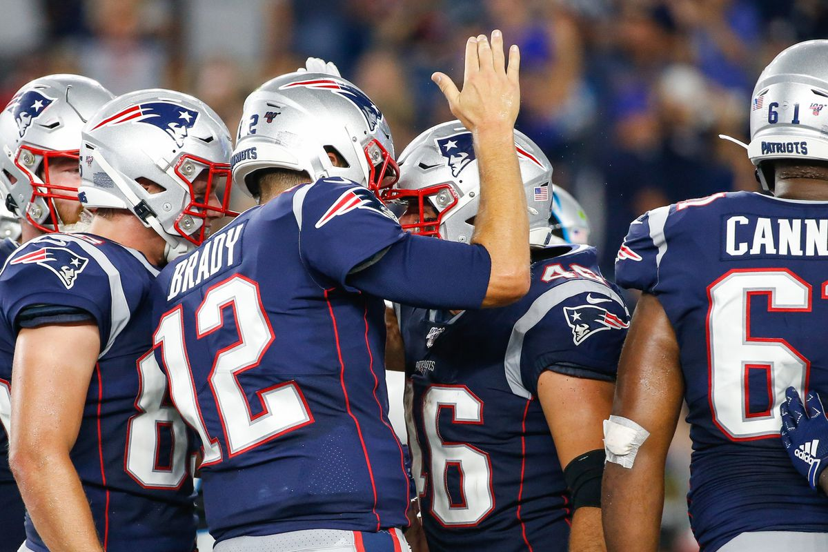 New England Patriots quarterback Tom Brady celebrates with fullback James Develin after a touchdown during the first half against the Carolina Panthers at Gillette Stadium.