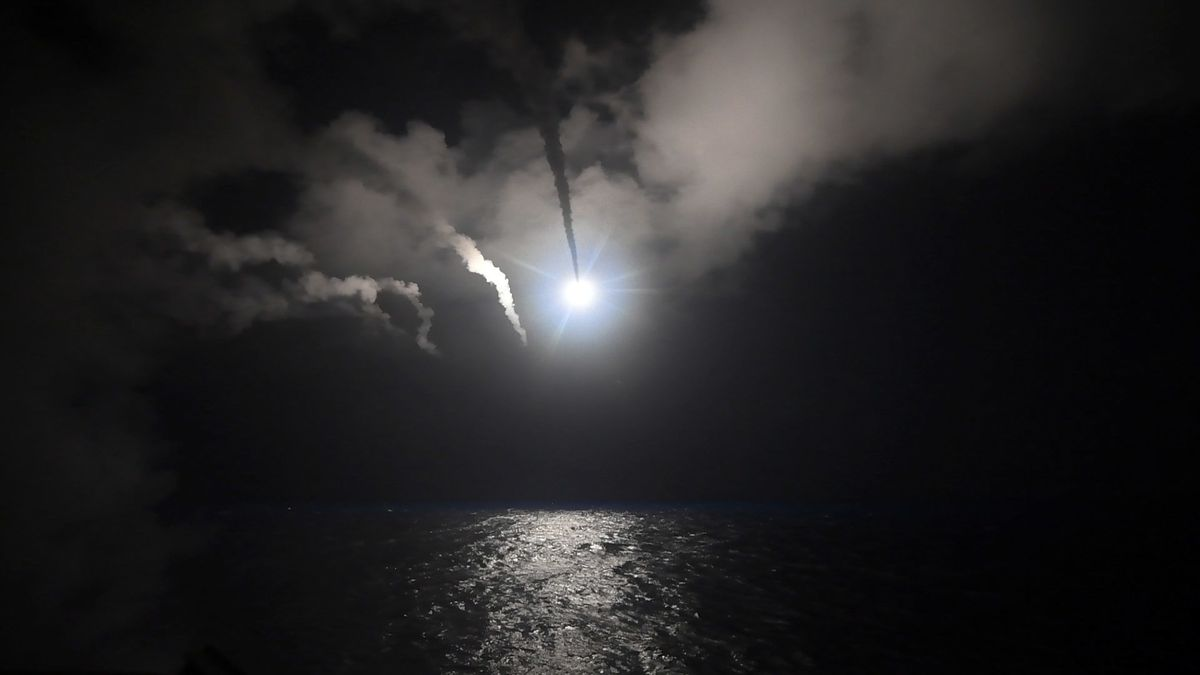 In this image provided by the U.S. Navy, the guided-missile destroyer USS Porter launches a Tomahawk cruise missile in the Mediterranean Sea on Friday. The United States blasted a Syrian air base with a barrage of cruise missiles in fiery retaliation for
