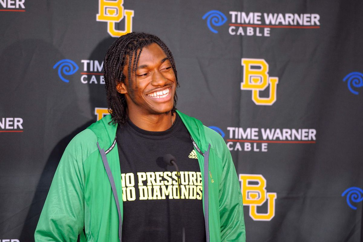 Mar 21, 2011; Waco, TX, USA; Baylor Bears quarterback Robert Griffin III (10) is interviewed by the press after the Baylor pro day at the Allison Indoor Facility. Mandatory Credit: Jerome Miron-US PRESSWIRE
