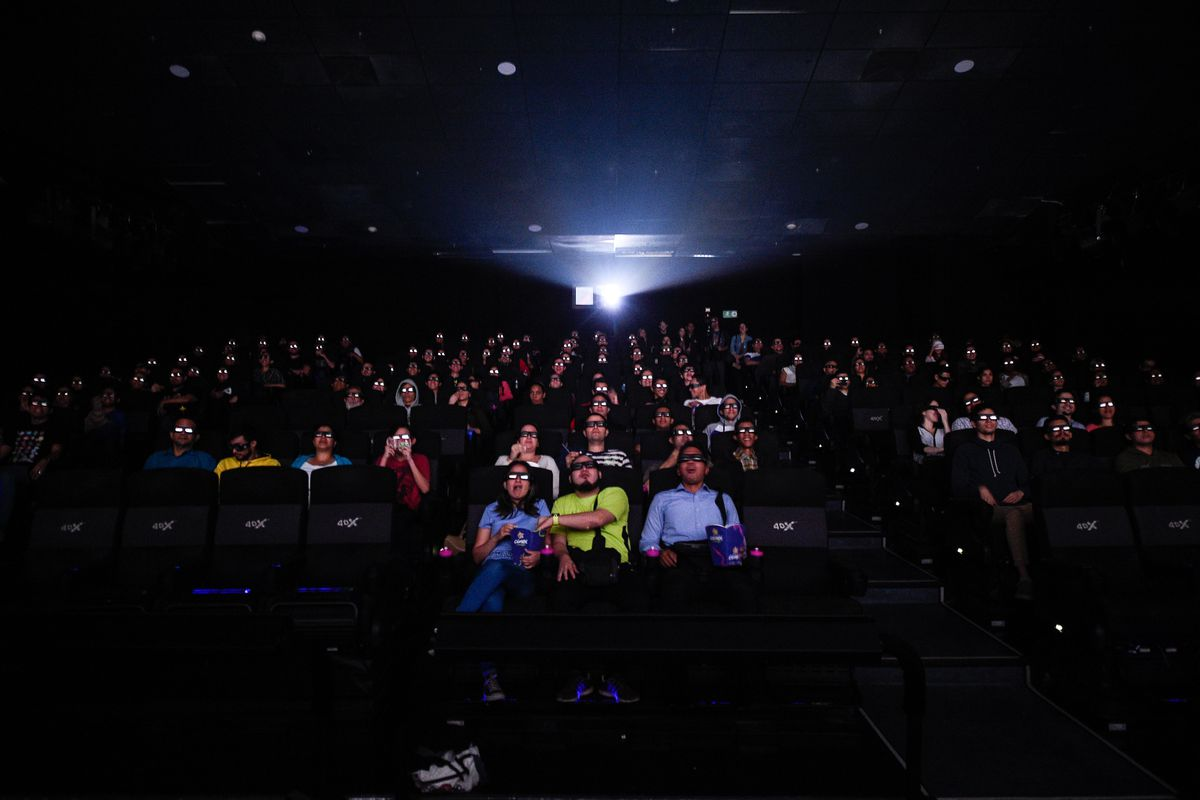 """Venezuelan filmgoers watch the first screening in Venezuela of Marvel Studios' """"Avengers: Endgame"""" at a cinema in Caracas on early April 26, 2019. - The """"Avengers: Endgame"""" movie was screened early morning in Caracas to work around blackout and safety issues."""