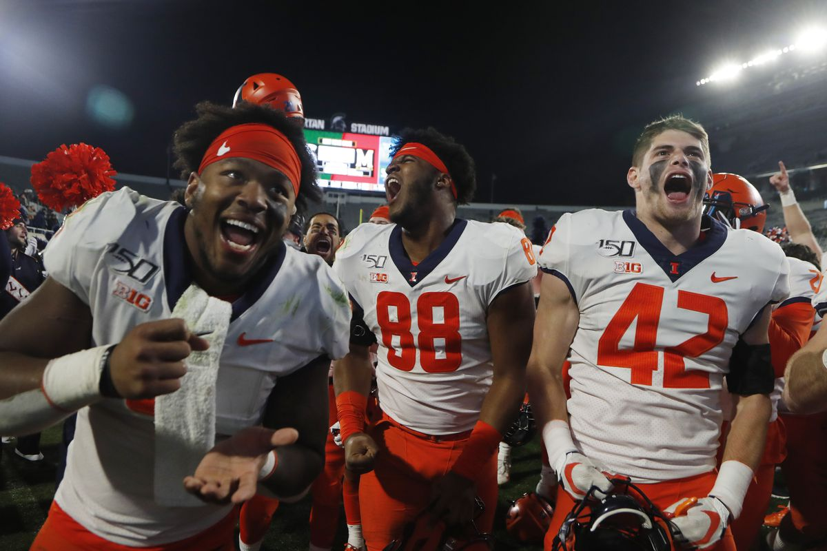 Illinois defensive lineman Keith Randolph Jr. (88), defensive back Michael Marchese (42) and others celebrate the team's 37-34 win over Michigan State Saturday in East Lansing, Mich.