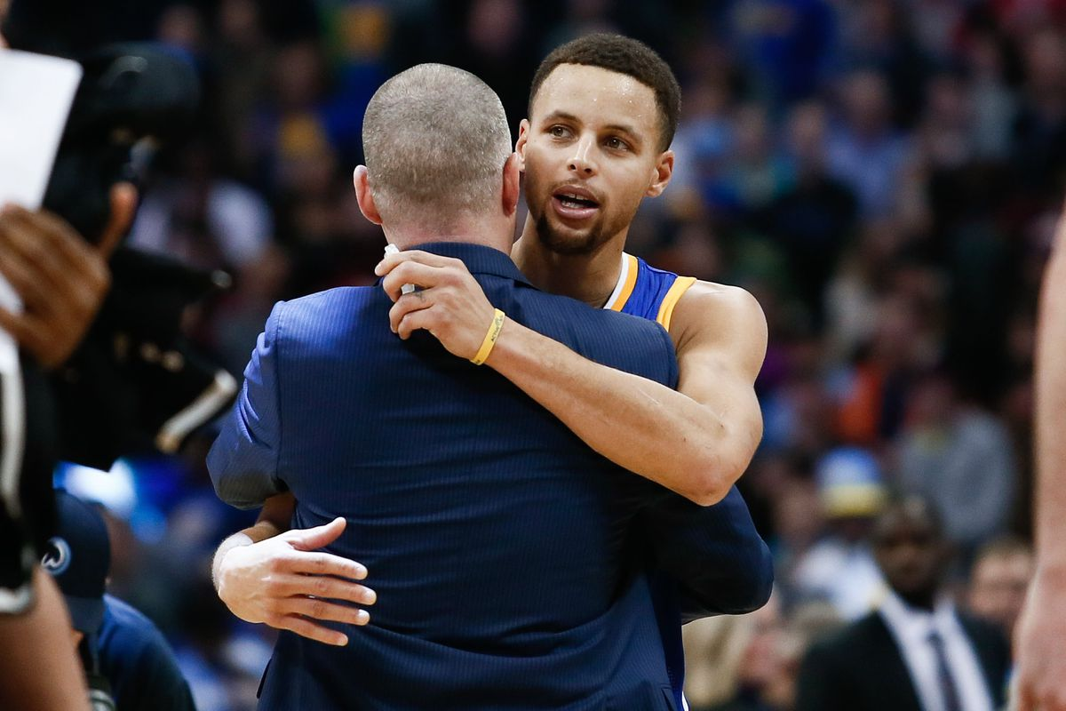 Steph Curry showing Michael Malone a little love on the occasion of a Nuggets win