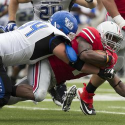 Ohio State Buckeyes running back Jordan Hall (7) dives for extra yardage as Buffalo Bulls defensive lineman Colby Way (34) tackles him at Ohio Stadium. Ohio State won the game 40-20.
