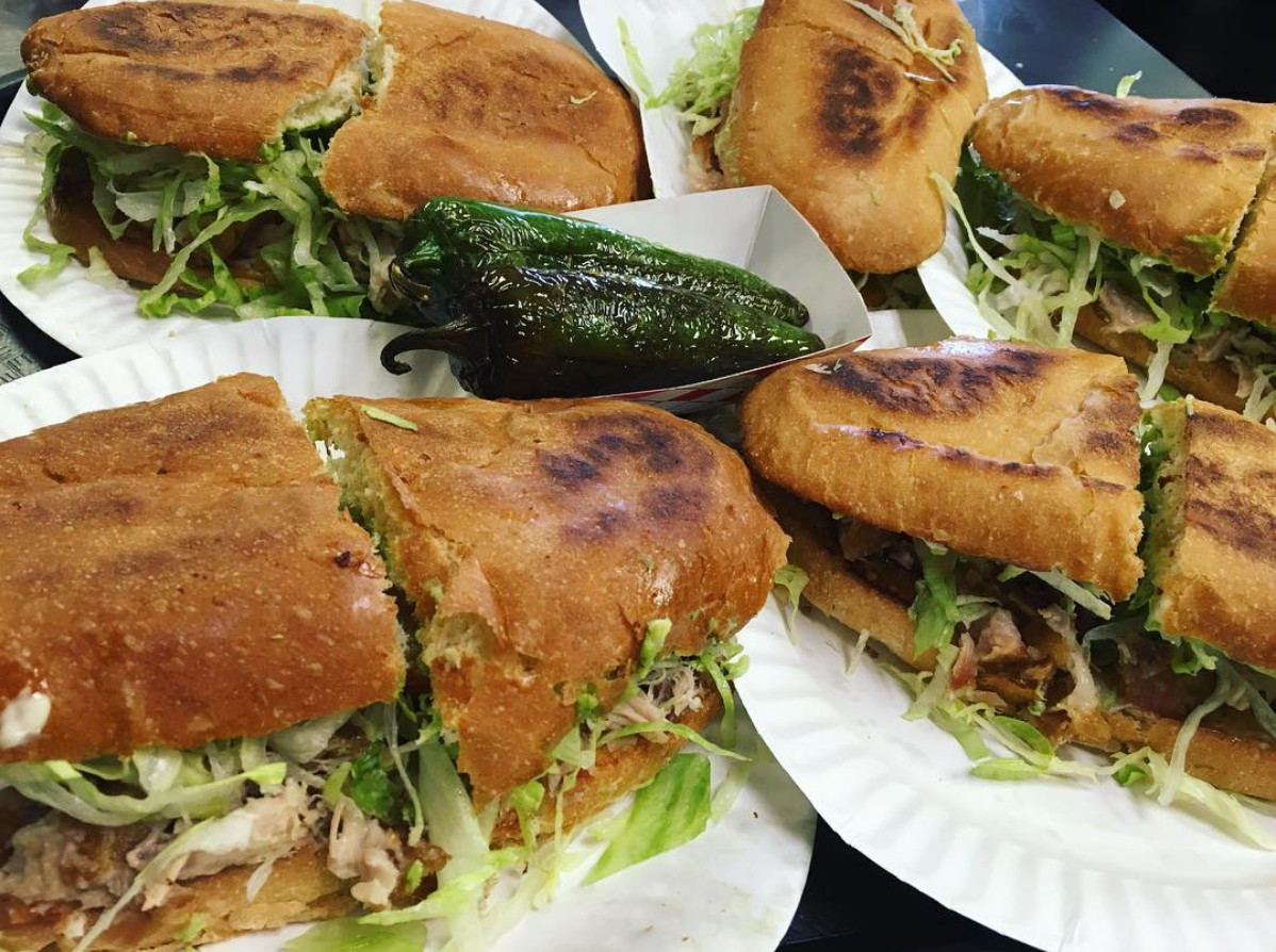 Four tortas on paper plates