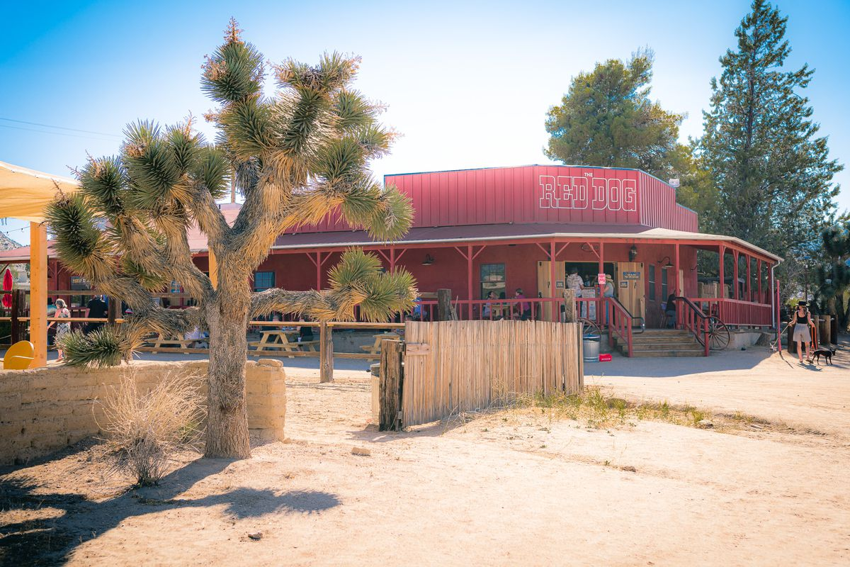 A corner look at a bright red new saloon in the middle of the California desert.