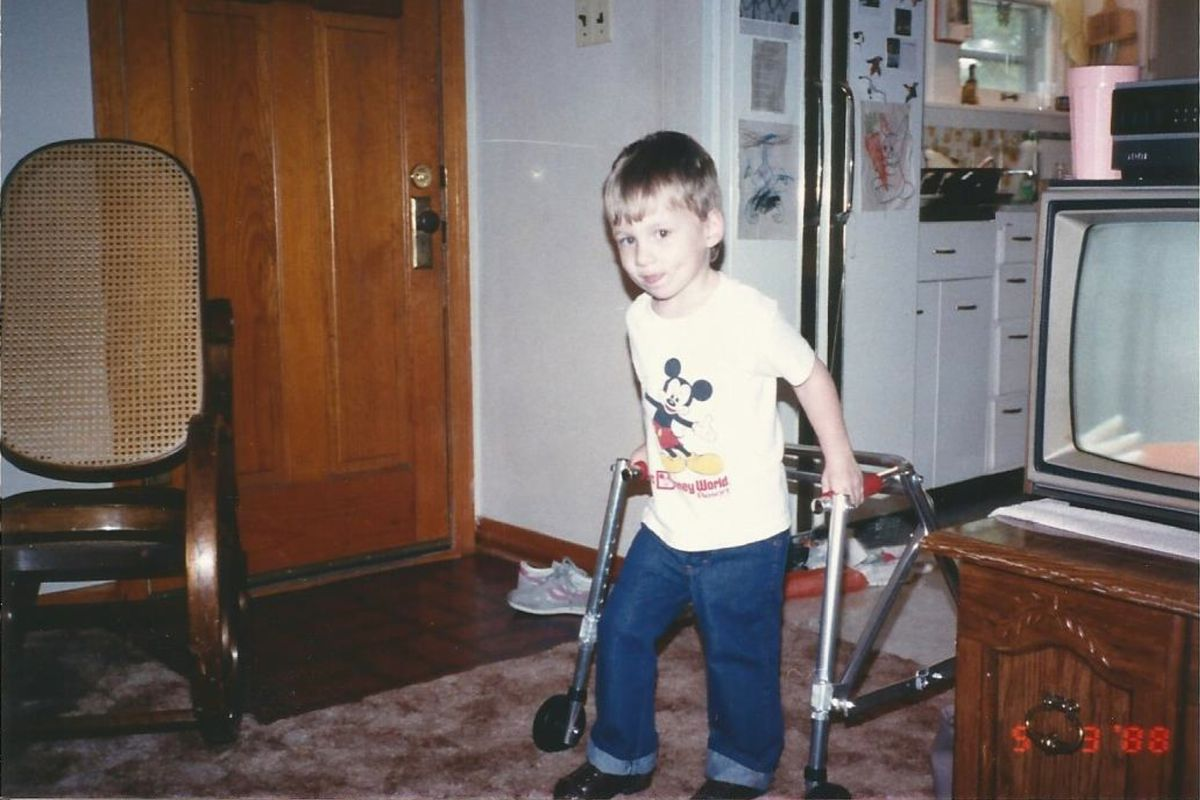 Me, learning to walk for the first time at the age of three.