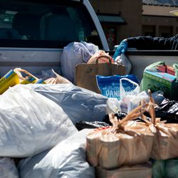 """Alex McDonald pauses while loading donations into a truck for the Ogden Rescue Mission and the Lantern House outside Kirt's Family Drive Inn in Ogden on Monday, May 25, 2020. """"I've been surprised, many people said 'thanks for giving us the opportunity to help, we just didn't know how,'"""" Grant Protzman said. """"There's a real need."""""""