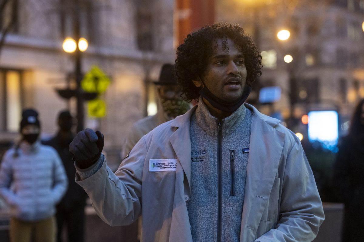 Anuddep Dasaraju an M.D. at UIC speaks to reporters with around 2 dozen activists, and medical professionals who rallied outside the Thompson Center, demanding that Mercy Hospital not be closed, Monday, Dec. 7, 2020. | Tyler LaRviere/Sun-Times
