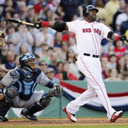 Boston Red Sox's David Ortiz, right, hits a two-run home run in front of Tampa Bay Rays' Jose Molina in the fifth inning of a baseball game in Boston, Saturday, April 14, 2012.