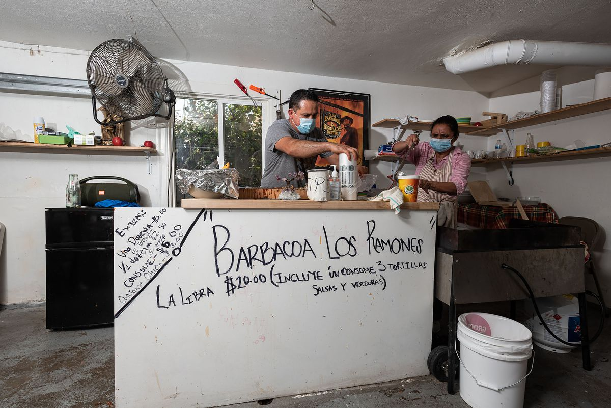 Ramon Coss and his mother-in-law Araceli Arreguin prepare goat barbacoa at Barbacoa Los Ramones in Richmond California.