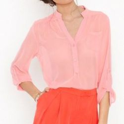"""<a href="""" http://www.nastygal.com/clothes-bottoms-shorts/working-girl-shorts-coral""""> Nasty Gal Working Girl shorts</a>, $58 nastygal.com"""