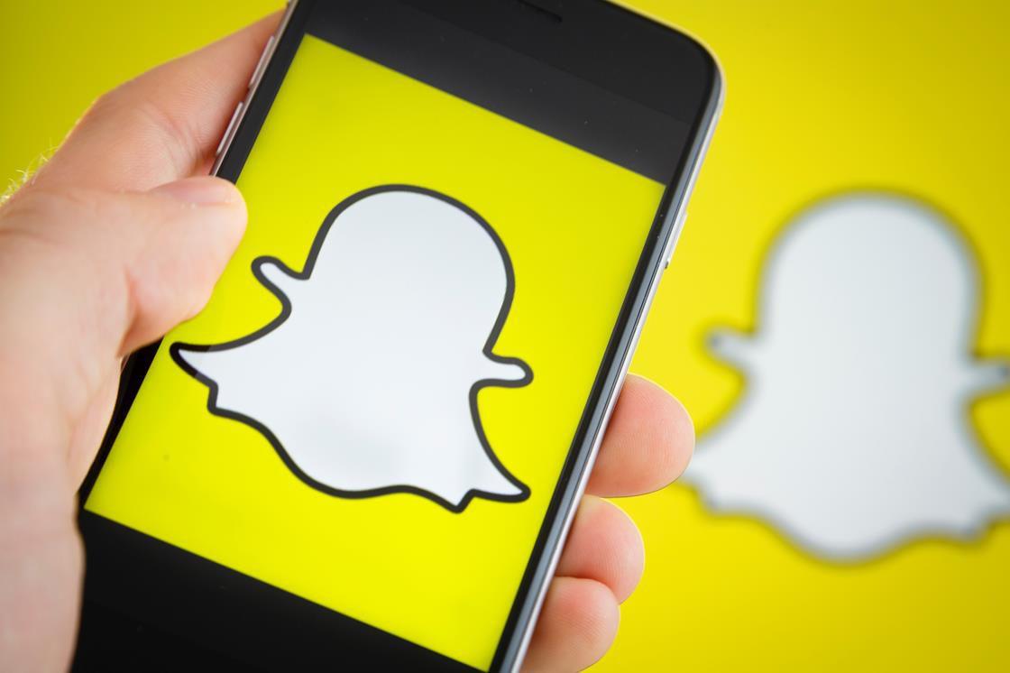 Snapchat logo on a phone
