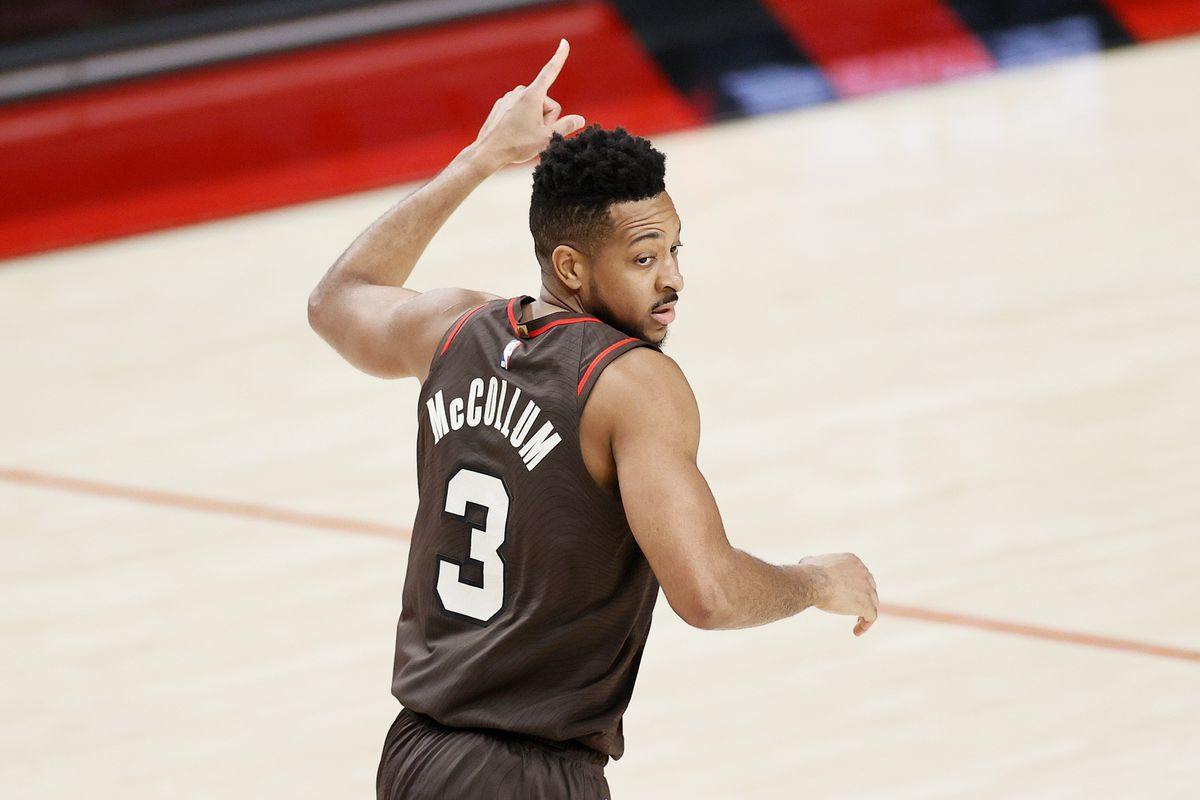 CJ McCollum #3 of the Portland Trail Blazers reacts after a basket against the Denver Nuggets during Round 1, Game 6 of the 2021 NBA Playoffs at Moda Center on June 03, 2021 in Portland, Oregon.