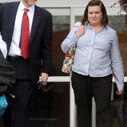 In a March 20, 2012 photo, Kimberly Saenz, right, walks with her attorney Ryan Deaton as they leave the Angelina County Courthouse in Lufkin, Texas. Saenz, a former Texas nurse accused of killing five kidney dialysis patients by injecting them with bleach, caused others to fear for their lives after they witnessed some of the injections, a prosecutor told jurors during closing arguments Thursday, March 29, 2012.