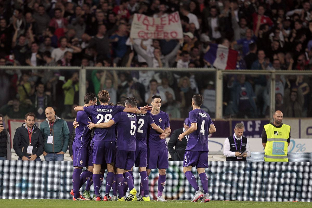 Borja celebrates his beautiful second goal with teammates under a well-positioned fan in the Curva. Photo