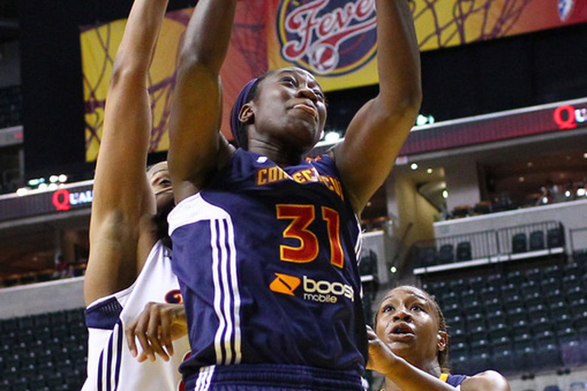 June 21, 2012; Indianapolis, IN, USA; Connecticut Sun center Tina Charles (31) snags a rebound against the Indiana Fever at Bankers Life Fieldhouse. Indiana defeated Connecticut 95-61. Mandatory credit: Michael Hickey-US PRESSWIRE