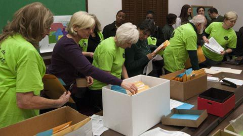 Volunteers prepare packets for delivery to lawmakers on Jan. 30. <em>Year of the Student photo</em>