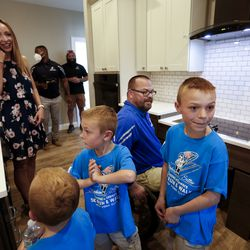 Tiffany Vendela, left, her husband, Purple Heart veteran U.S. Army Sgt. 1st Class Travis Vendela, center, and their three sons, Kaiden, Trayden and Quentin, check out the kitchen of their new home in Huntsville, Weber County, on Friday, July 3, 2020.