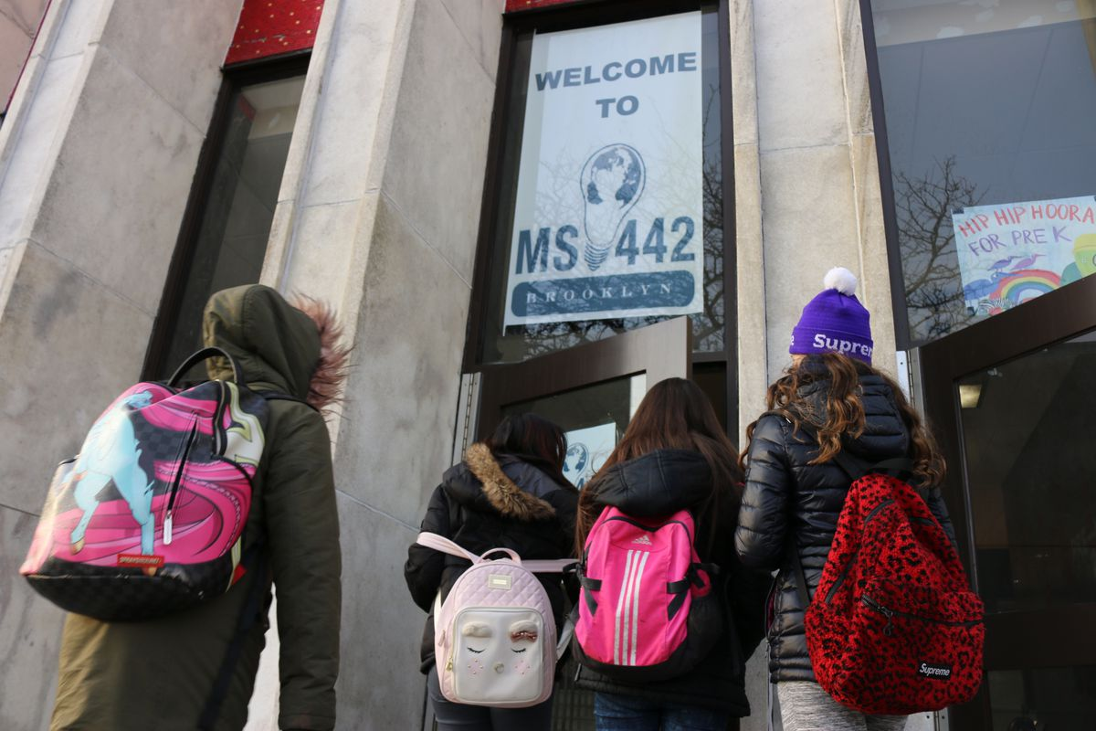Students start the school day at M.S. 442 in District 15. The school lost federal Title I funding after the number of needy students enrolled there declined, an issue that more schools in the district could face now that an integration plan is in place.
