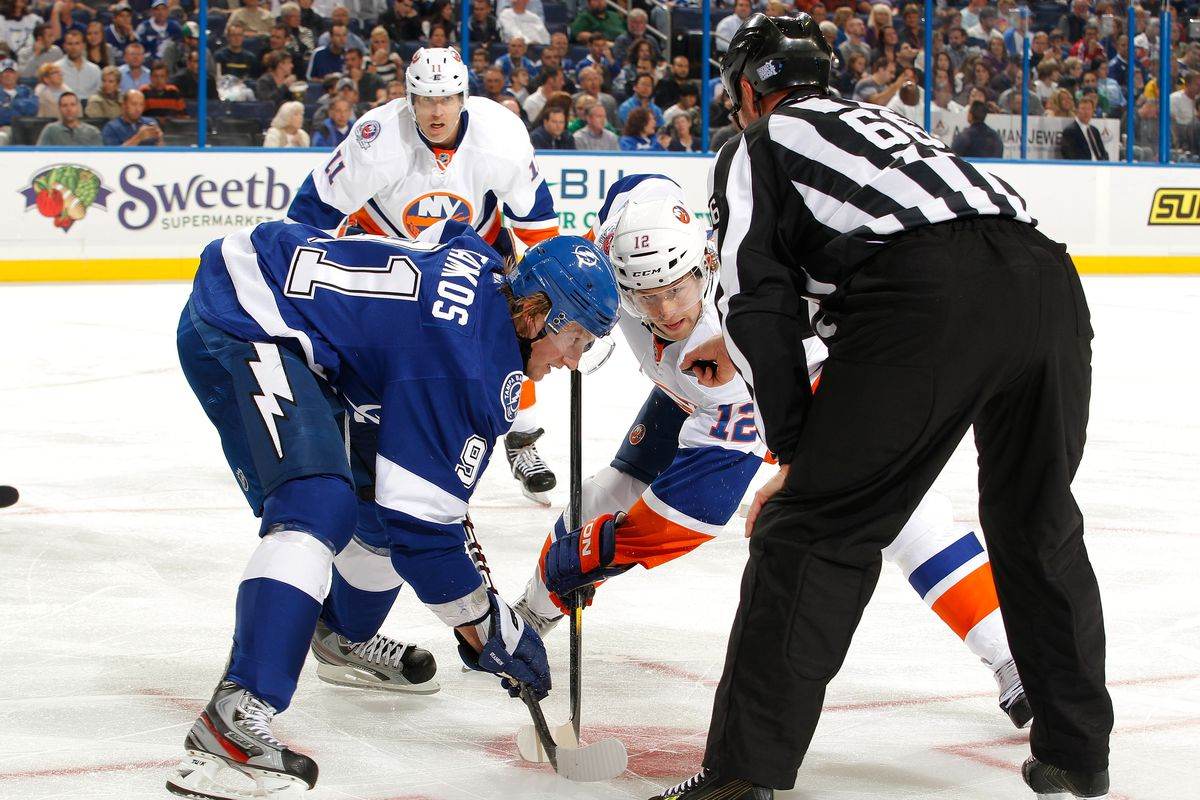 Steven Stamkos #91 of the Tampa Bay Lightning prepares for the face-off against Josh Bailey #12 of the New York Islanders at the St. Pete Times Forum on October 20, 2011 in Tampa, Florida.