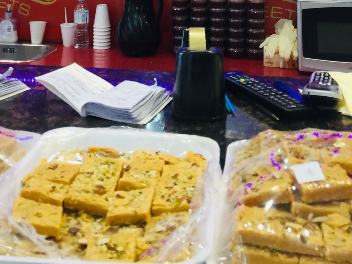 Mithai on the counter at Noormahal Sweets, one of the best north Indian restaurants in London