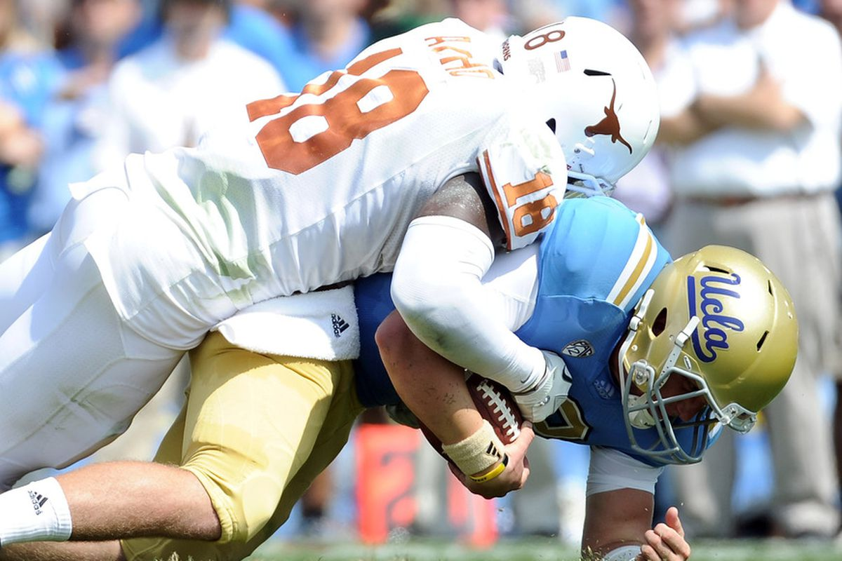 Emmanuel Acho (18) of the Texas Longhorns sacks Richard Brehaut (12) of the UCLA Bruins during the second quarter at Rose Bowl on September 17, 2011 in Pasadena, California. (Photo by Harry How/Getty Images)