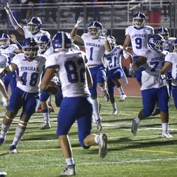 The Bingham bench explodes onto the field after Joshua Woolf (82), center, caught a pass in the end zone for a two-point conversion, giving the Miners an overtime victory over the Leopards at East High School in Salt Lake City on Friday, Sept. 25, 2020.