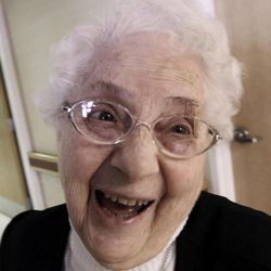 In this April 10, 2012, photo, sister Annette Bouchard, 94, smiles into the camera at St. Joseph Convent in Biddeford, Maine. Good Shepherd Sisters of Quebec has just six convents in Maine and Massachusetts with fewer than 60 sisters. The youngest is 64, and it's been more than 20 years since a new member has joined. Sister Elaine Lachance is using the Internet, social media and even a blog to attract women who feel the calling to serve God.