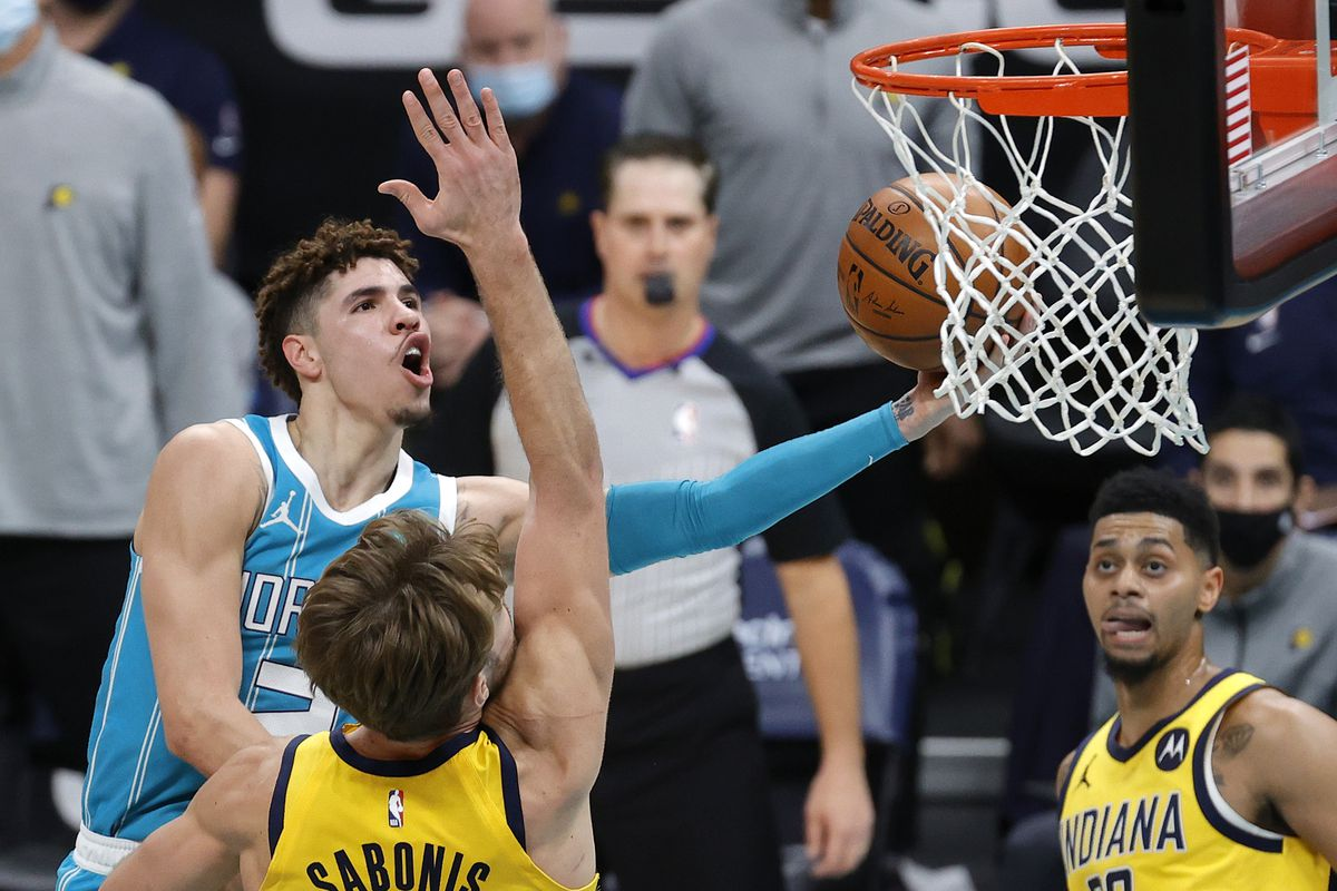 LaMelo Ball of the Charlotte Hornets drives to the basket during the fourth quarter of their game against the Indiana Pacers at Spectrum Center on January 29, 2021 in Charlotte, North Carolina.