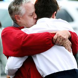 David Fowers kisses his son, Dan, a ninth-grader, after a lockdown was lifted at Mueller Park Junior High School in Bountiful on Thursday, Dec. 1, 2016. Flowers was in the room when his classmate fired a gun.