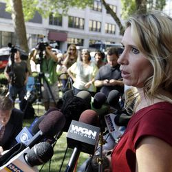 Pam Bosco, a family spokesperson for Stacy Peterson, speaks outside the Will County Courthouse in Joliet, Ill., Thursday, Sept. 6, 2012, after a jury convicted former Bolingbrook, Ill., police officer Drew Peterson of murdering his third wife, Kathleen Savio, in 2004. Peterson, the former suburban Chicago police officer who generated a media storm after his much-younger fourth wife, Stacy Peterson, vanished in 2007, was convicted in a case based mainly on secondhand hearsay statements from the two women.