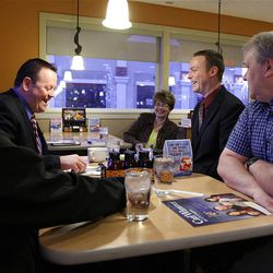 Delegates listen to Carl Wimmer, second from left, a candidate for the 4th Congressional District, at IHOP in West Jordan, Wednesday, April 4, 2012.