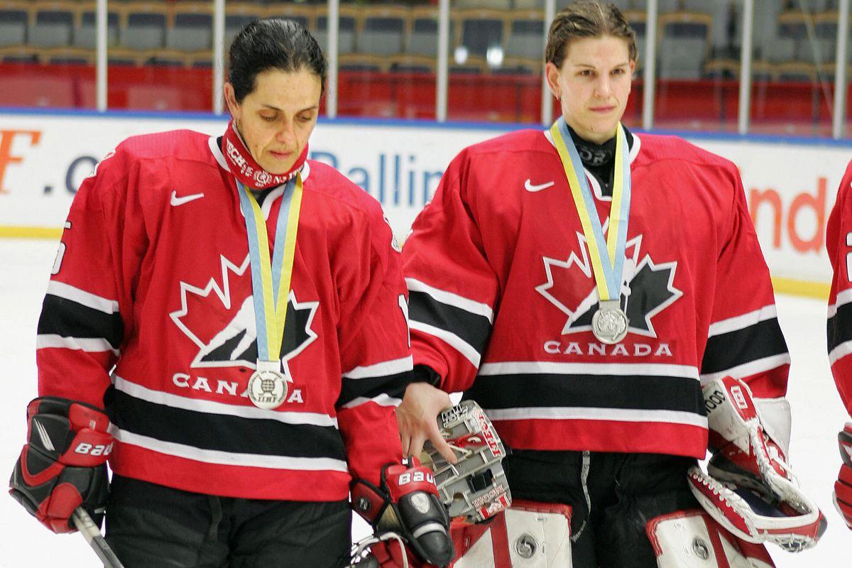 Canada's Danielle Goyette (L) and goalke