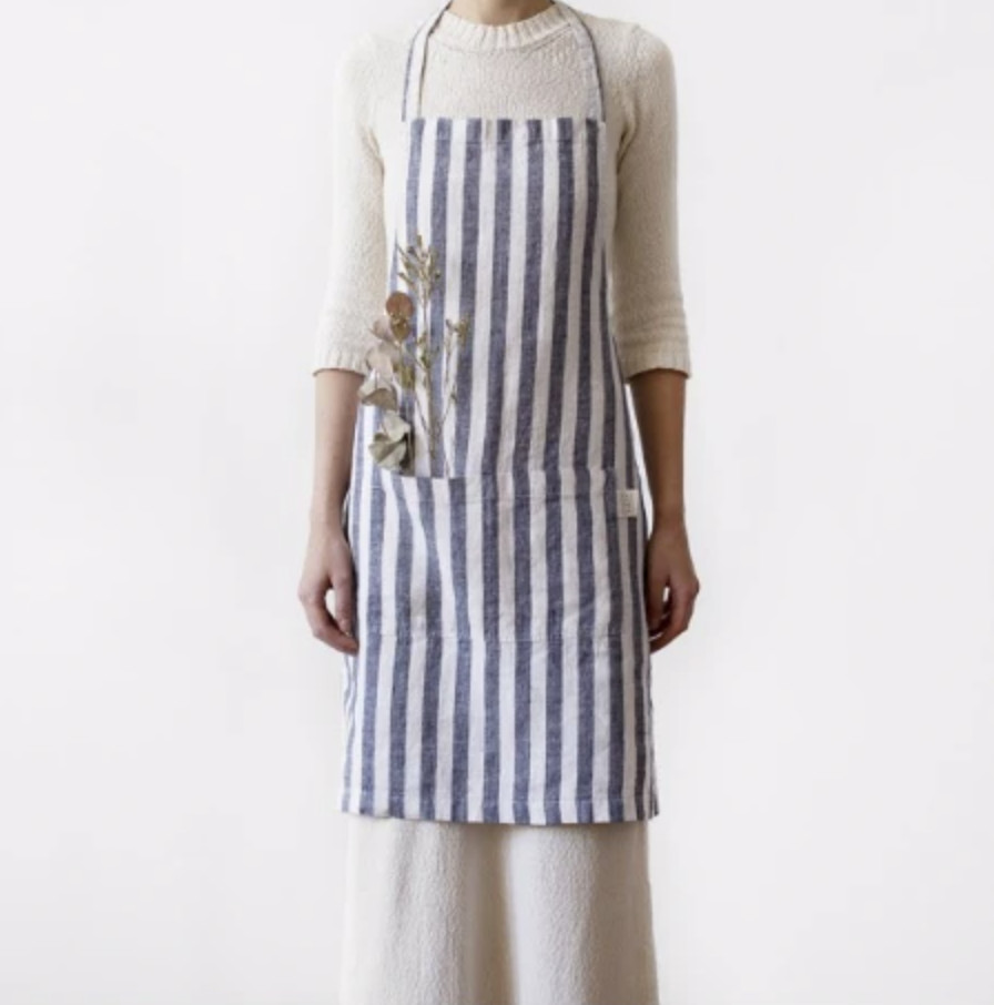 This apron from Honey and Co is some of the best restaurant merch to buy in London