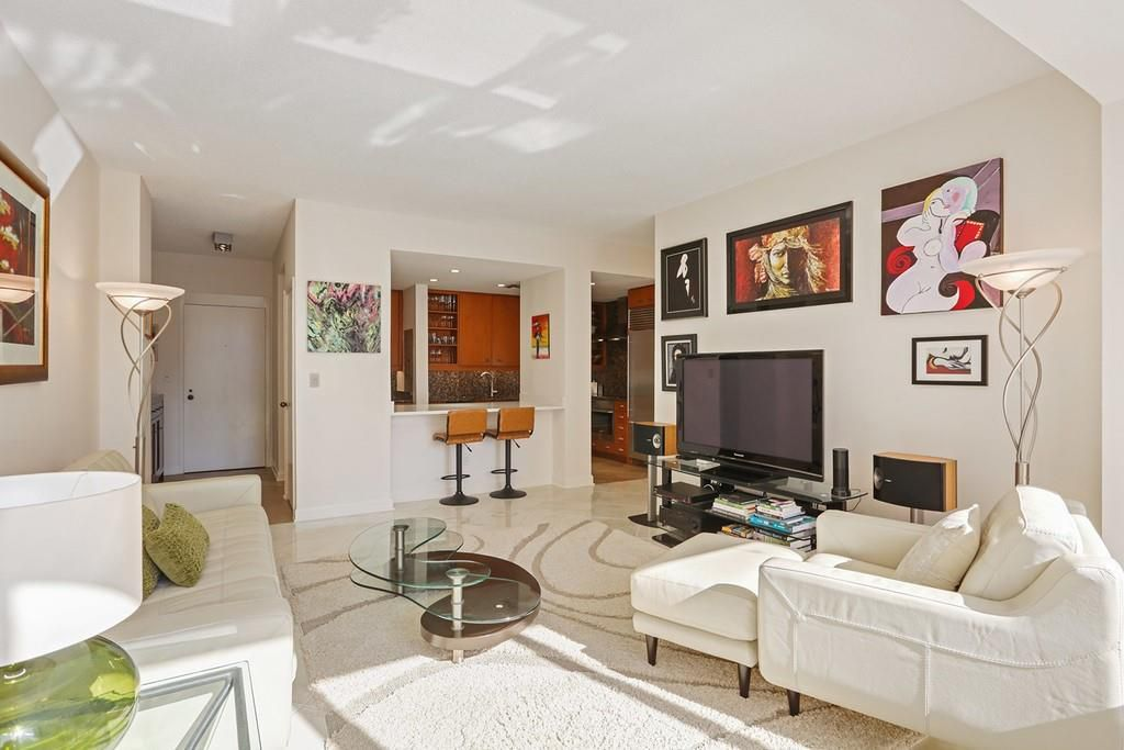 A white living room with cheap art all around it.