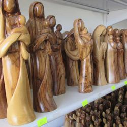 Olive wood Mother and Child figurines created and sold in Bethlehem.
