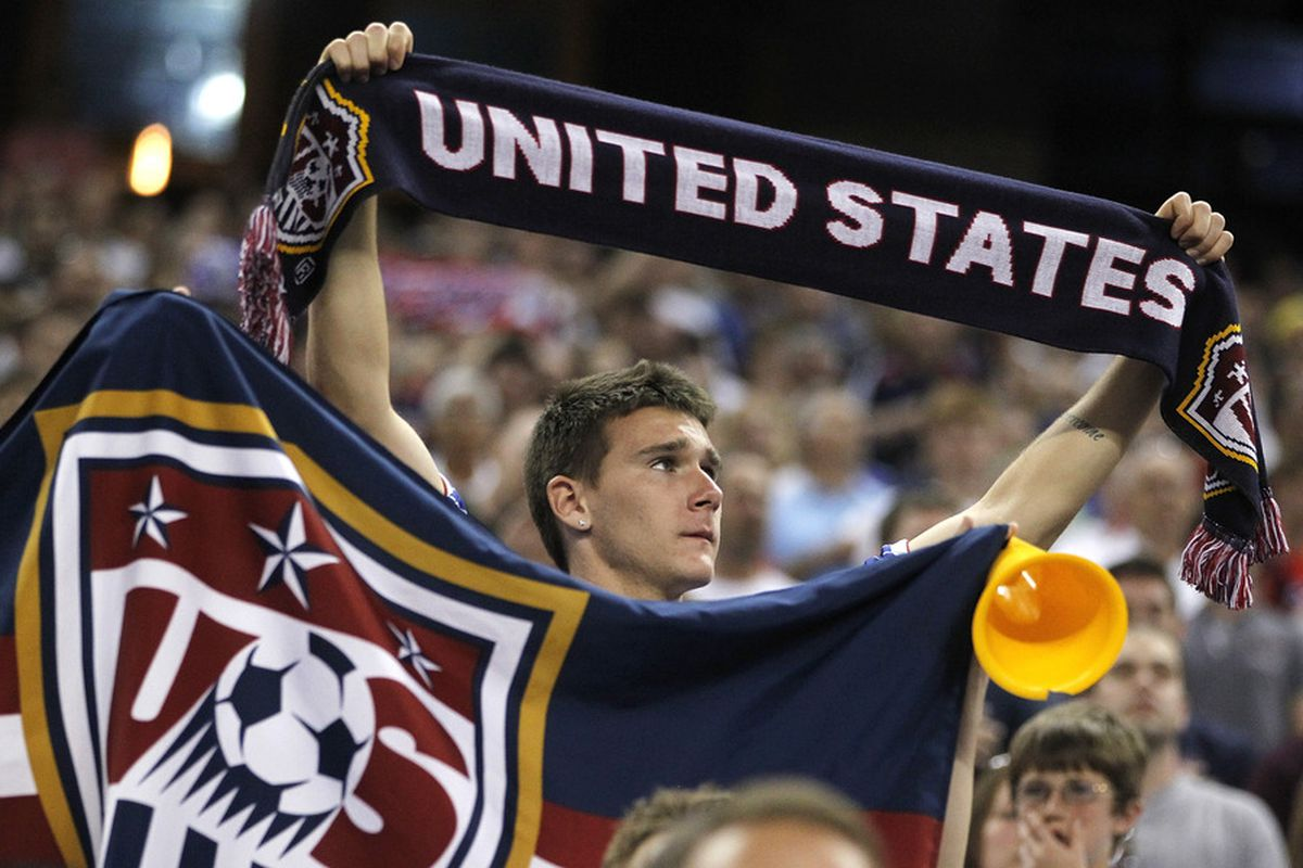 A fan cheers on the US MNT. You should be, too!