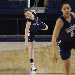 UConn's Katie Lou Samuelson stretches in front of Gabby Williams.