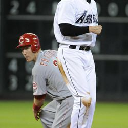 Cincinnati Reds' Todd Frazier, left, and Houston Astros' Tyler Greene look to first base to see that Reds' Scott Rolen is out at first for a double play in the second inning of a baseball game Friday, Aug. 31, 2012, in Houston.