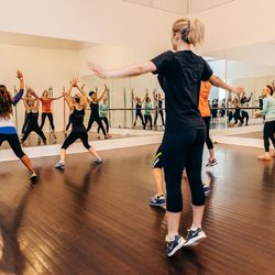 Simone is the trailblazer, adding her own shimmies and thrusts as we run through the entire routine. The <b>intensity is on par</b> with the Tracy Anderson cardio I've tried before, but Miss De La Rue <b>adds a hip-hop edginess</b> that makes the class <b