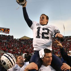 BYU quarterback John Beck is carried by Jacob Bower after  Brigham Young University defeated the University of Utah 33-31 in football in Salt Lake City, Utah Nov. 25, 2006.  Photo by Tom Smart