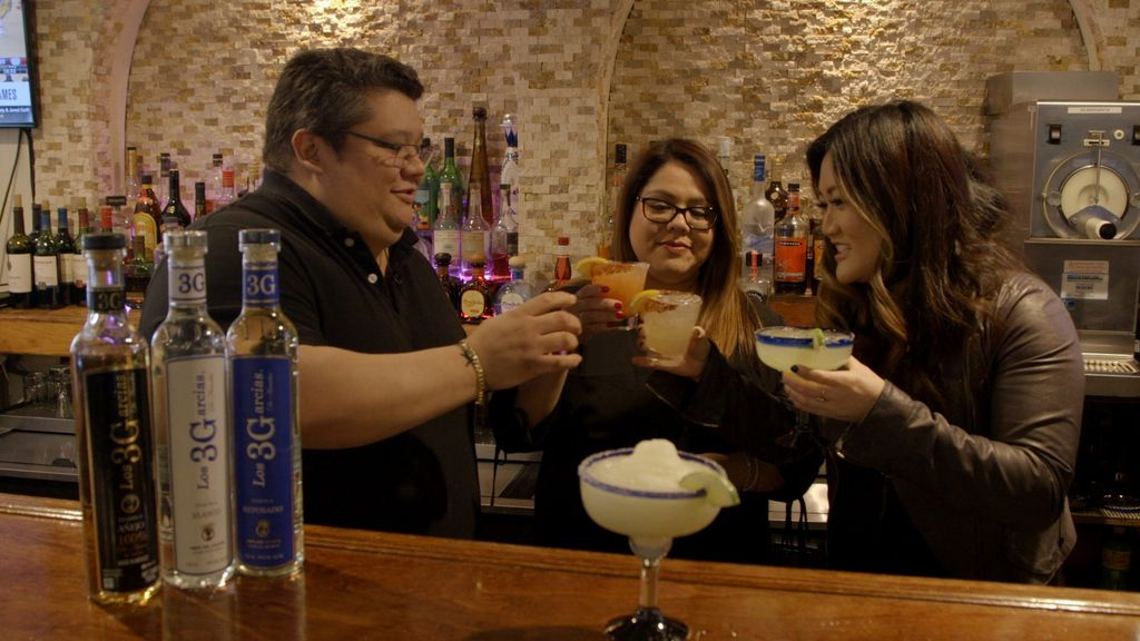 Ji Suk Yi enjoys cocktails with Carlos and Karla Garcia, co-owners of Tecalitlan restaurant.   Brian Rich/Sun-Times