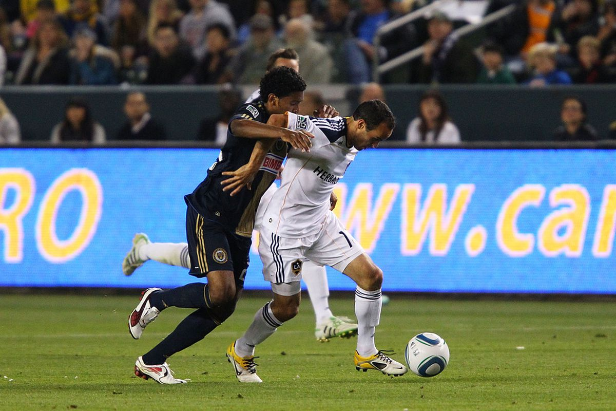 CARSON, CA - APRIL 02:  Landon Donovan #10 of the Los Angeles Galaxy fights off a defender during the Philadelphia Union v Los Angeles Galaxy Match at The Home Depot Center on April 2, 2011 in Carson, California.  (Photo by Joe Scarnici/Getty Images)