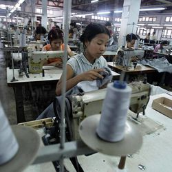 In this photo taken Saturday, April 21, 2012, young workers use sewing machines at a garment factory in Yangon, Myanmar. On Monday, April 23, 2012, the European Union confirmed it was suspending most of its sanctions against Myanmar to reward the country's recent wave of political reform. The suspension of trade sanction could help revive the nation's industries, restoring some of the 80,000 garment industry jobs lost here over the past 10 years.