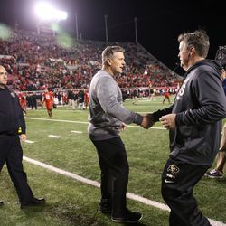 Utah Utes head coach Kyle Whittingham and Colorado Buffaloes head coach Mike MacIntyre shake hands after the game at Rice-Eccles Stadium in Salt Lake City on Saturday, Nov. 25, 2017.